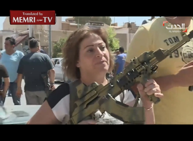 Lebanese Women Bear Arms to Defend Town of Al-Qaa after Suicide Bombings