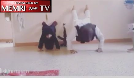 Instagram Video Shows ISIS Father-Daughter Workout as Toddler Plays with Gun